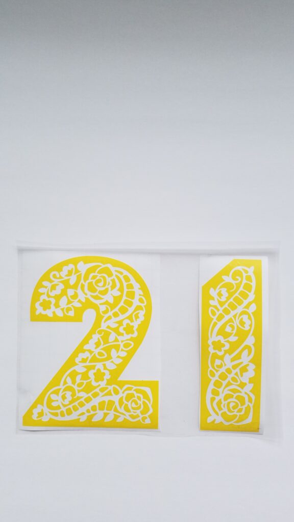 yellow vinyl number 21 cut out with floral pattern in numbers
