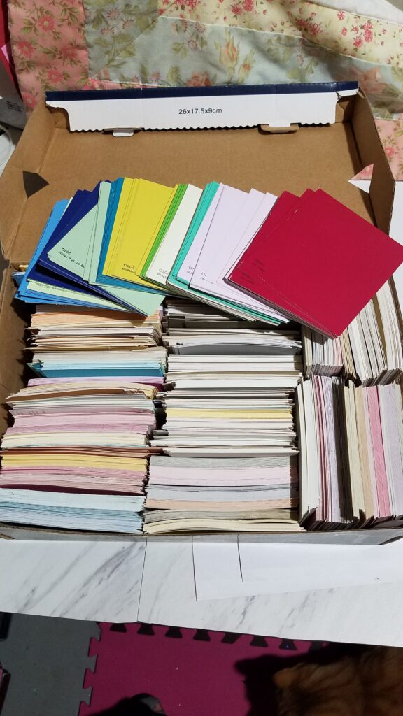 box of various colors of paint chip sample cards