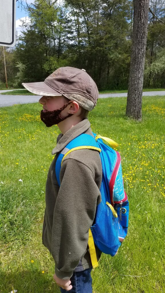 side view of yarn beard on child