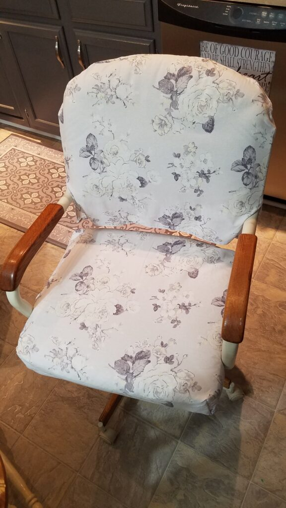 slipcovered kitchen chair with gray and white floral fabric