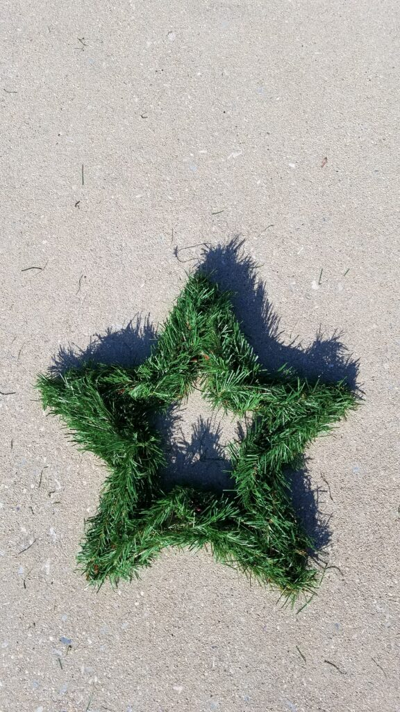 5 pointed star shaped wreath with faux greenery