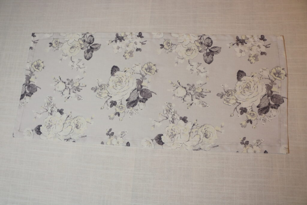 gray and white flowered table runner
