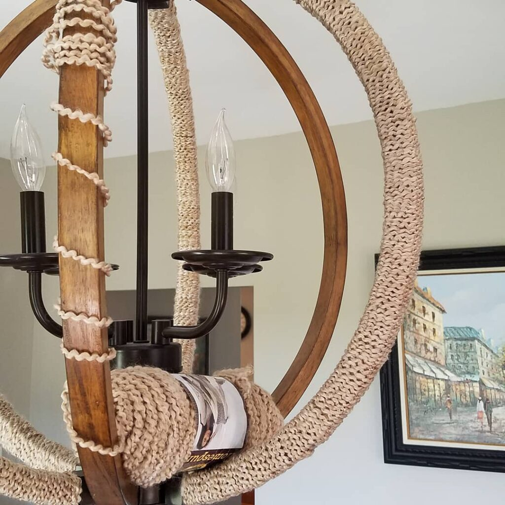 yarn partially wrapped around chandelier