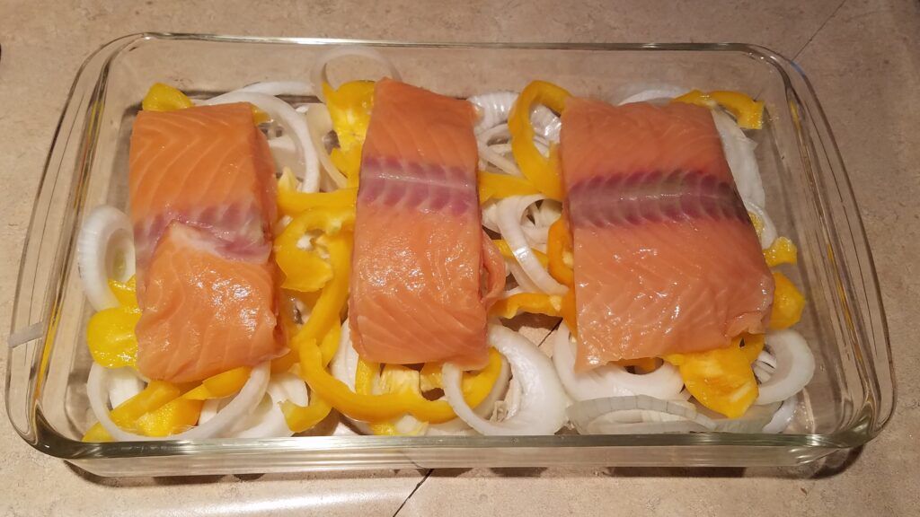 raw salmon, yellow bell peppers, and onions
