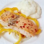 plated salmon with yellow bell peppers and mashed potatoes