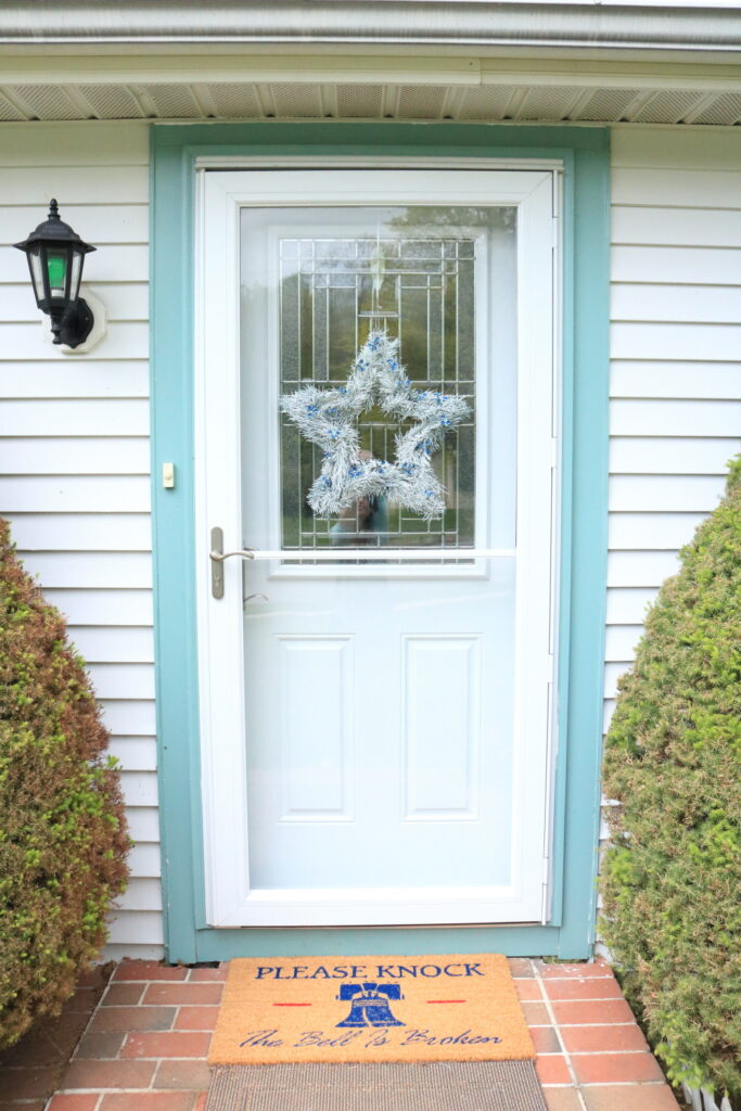 Patriotic Door with white star wreath and Liberty Bell doormat