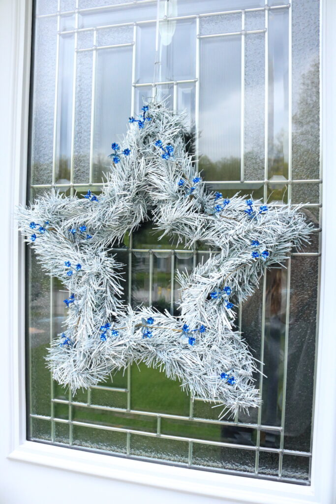white 5 point star wreath with blue accents