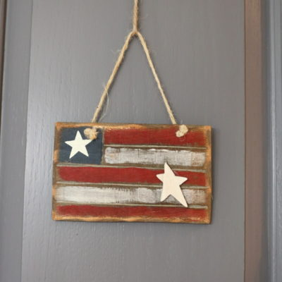 wooden flag ornament hung with jute string
