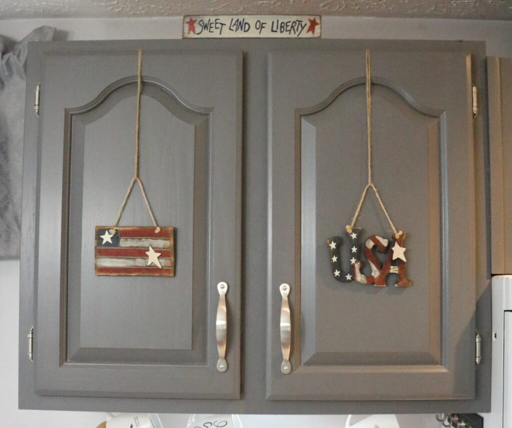 wooden patriotic ornaments on kitchen cupboards