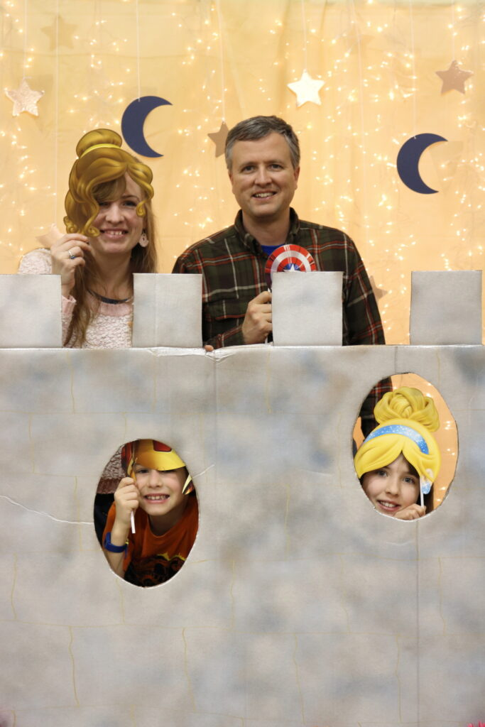 family of four photographed with castle, stars, and moons photo booth