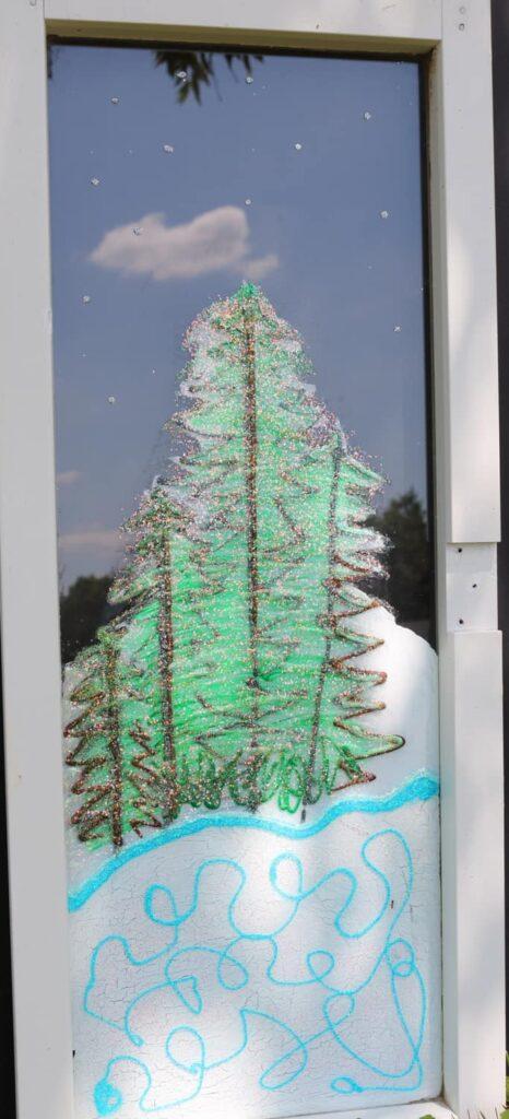 evergreens painted on window