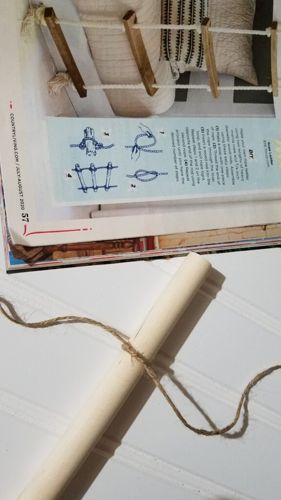 jute rope tied around a dowel rod, next to a magazine picture of a rope ladder