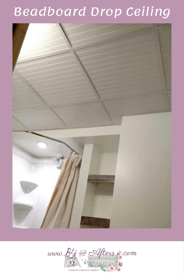 bathroom with a white beadboard drop ceiling