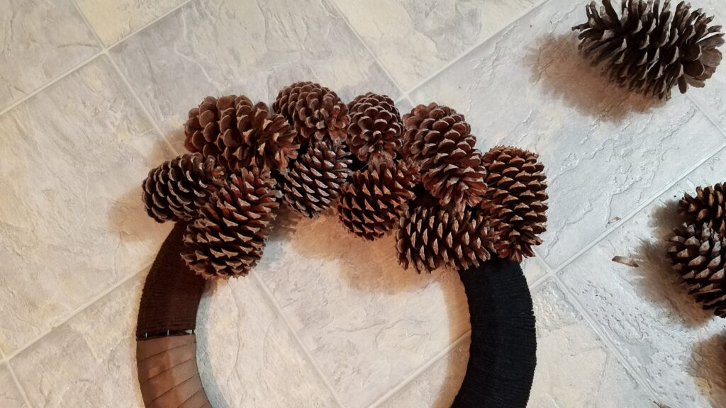 pine cones glued to part of a wreath frame