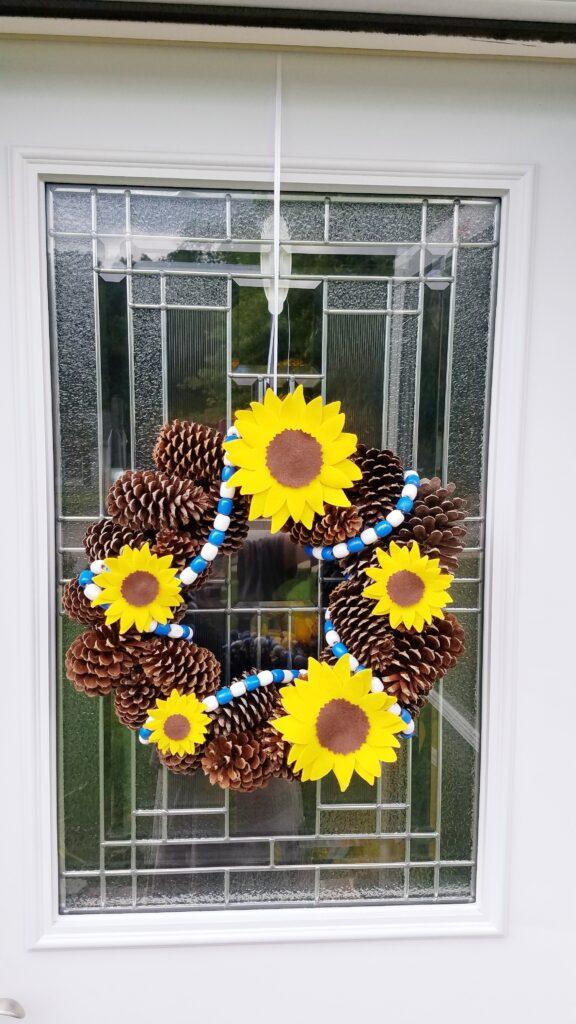 sunflower pine cone wreath idea