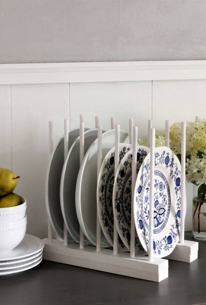 white DIY plate rack with blue and white plates