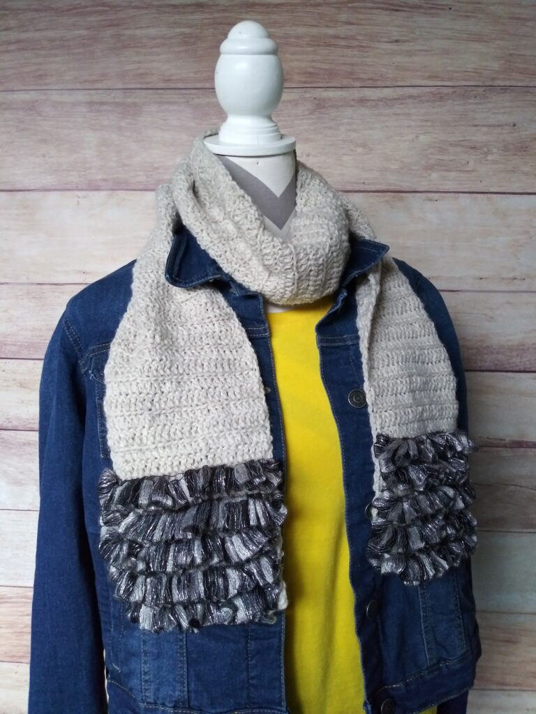 light gray scarf with scalloped edge
