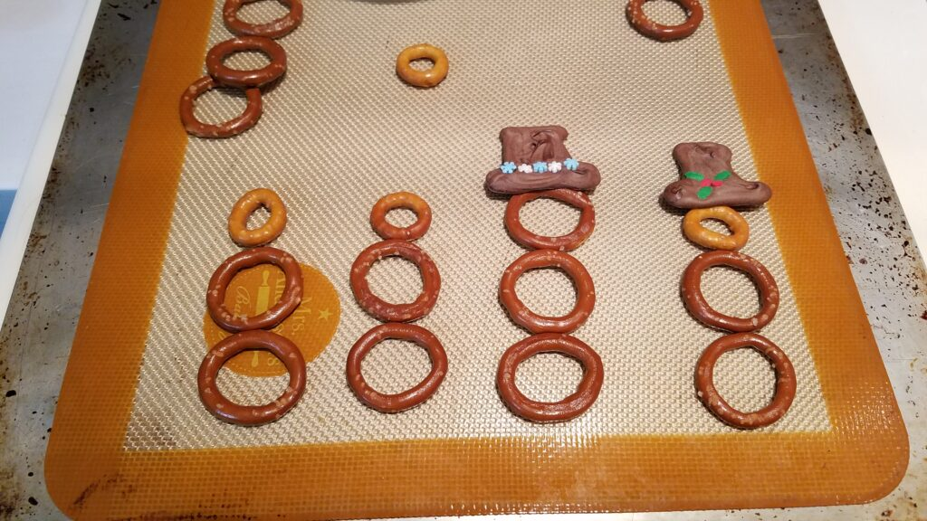pretzels arranged like snowmen