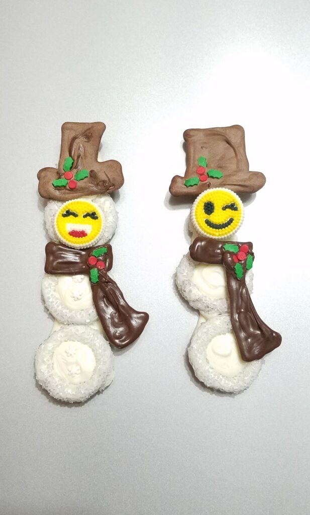 chocolate covered snowmen with emoji faces