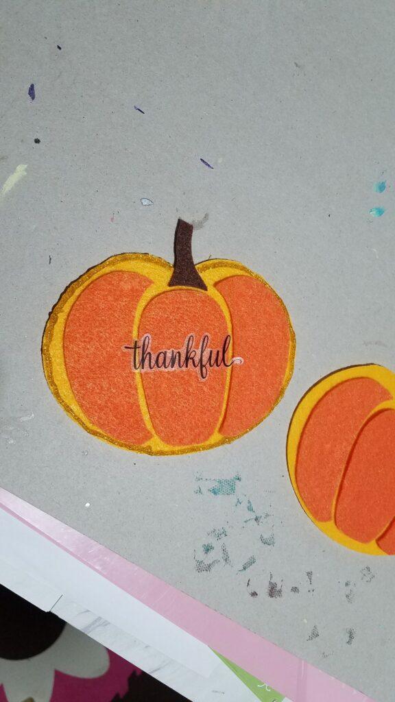 thankful sticker on felt pumpkin