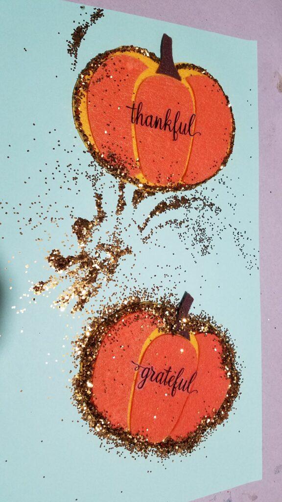 glitter on felt pumpkins