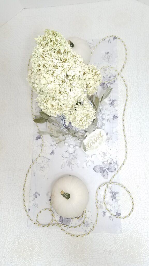 white pumpkin centerpiece with dried white hydrangea flowers