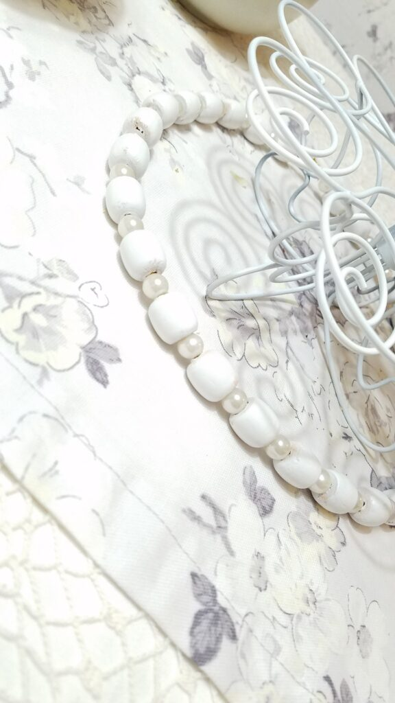 large pearl and wood bead garland