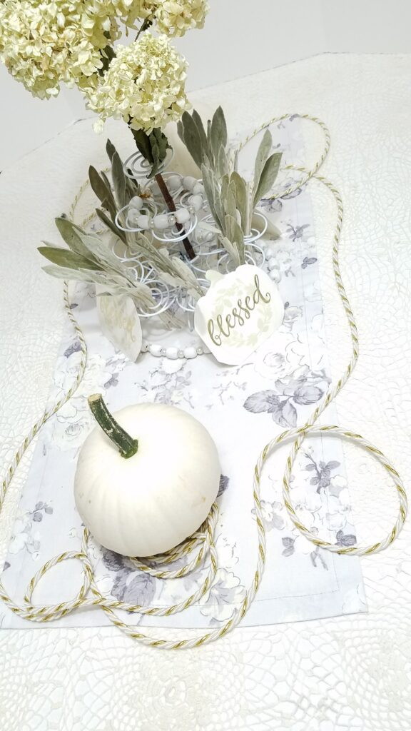 white pumpkin centerpiece with dried flowers