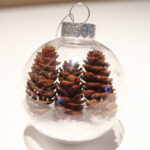 3 mini pinecones in a clear ornament