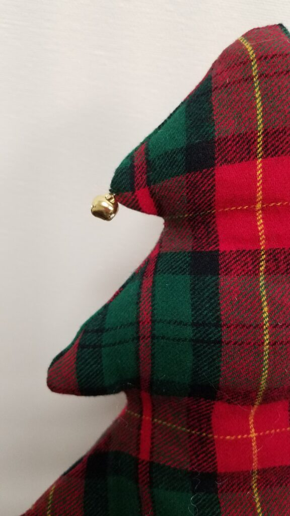jingle bell on a fabric tree