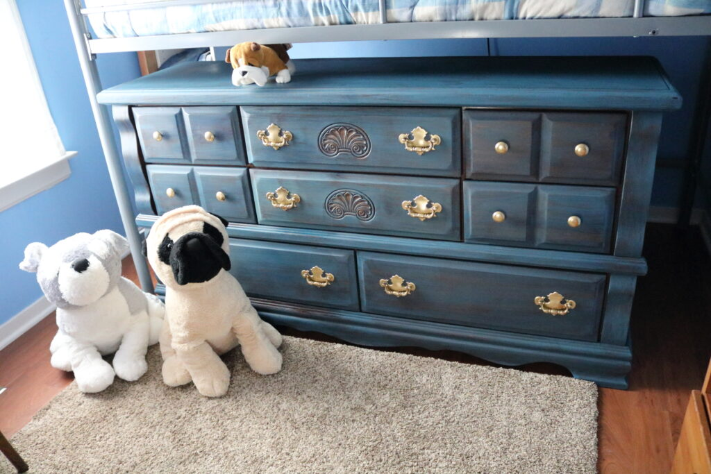 stuffed dogs with blue milk paint dresser