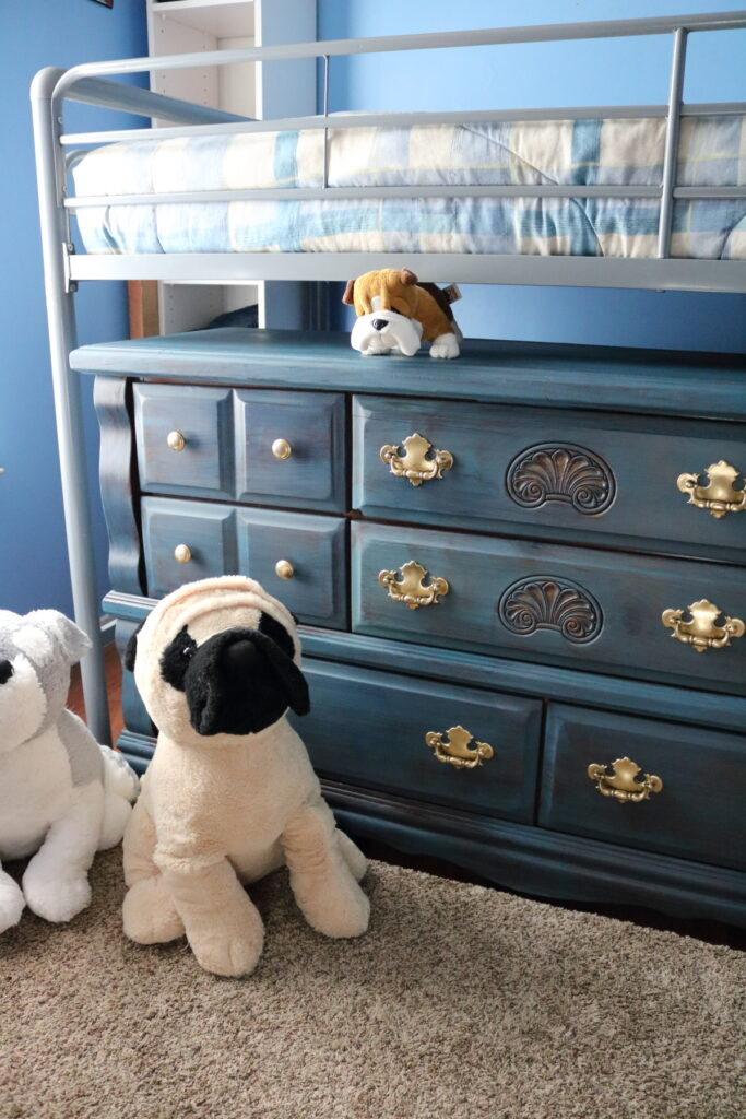 blue dresser with stuffed dogs