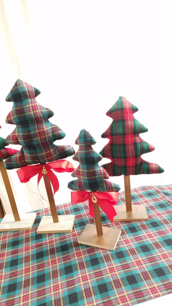 red ribbon on fabric Christmas trees