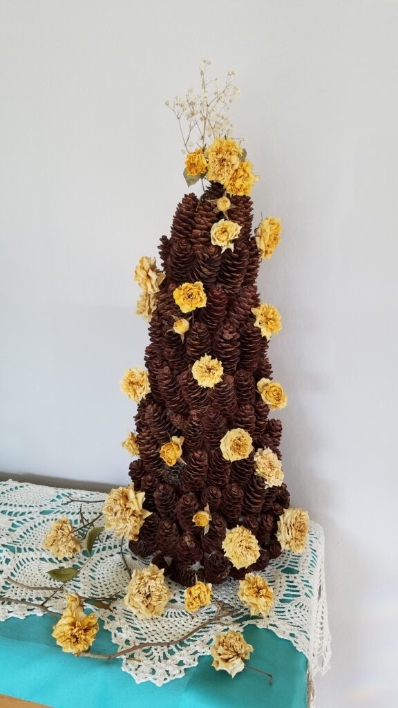 yellow rose pine cone tree