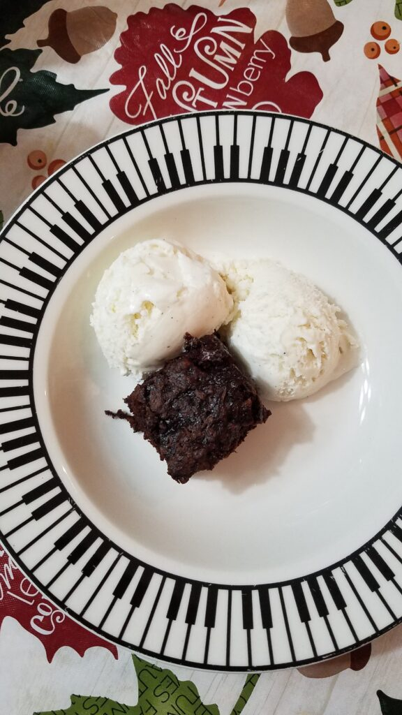 vanilla ice cream and zucchini brownie in a piano bowl