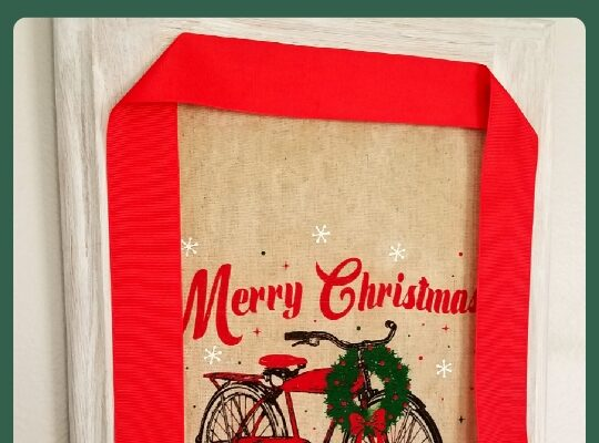 Cupboard door with a fabric burlap bag sign and red ribbon