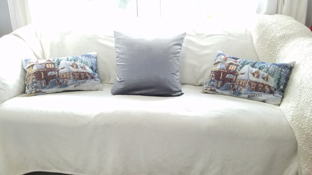 Winter Scene pillows on a couch