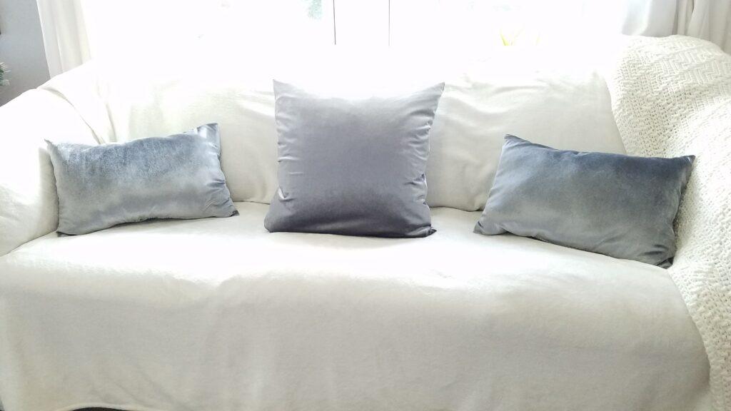 silver velvet pillows on couch