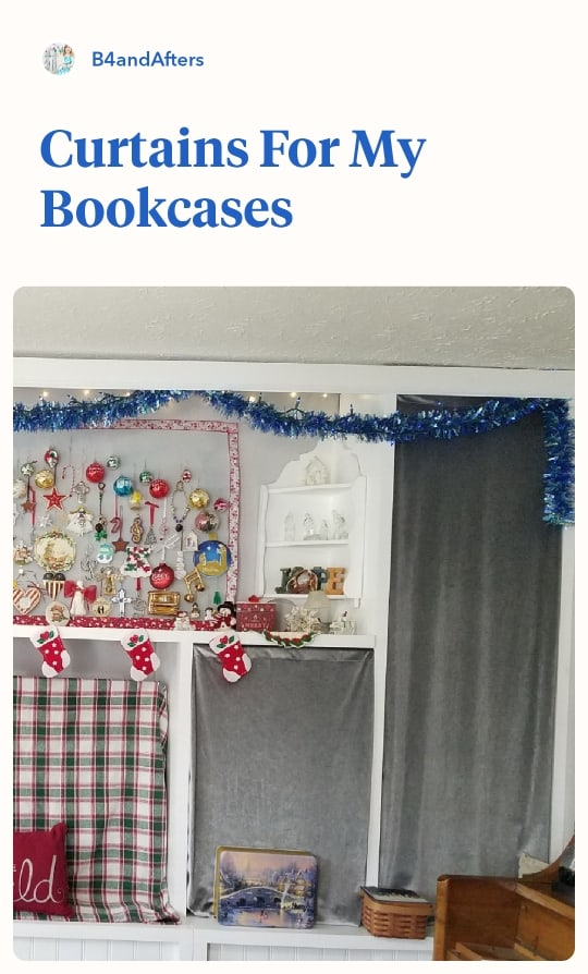silver velvet curtains on bookcases decorated for Christmas