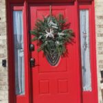wreath made in a snowflake pattern with faux evergreens