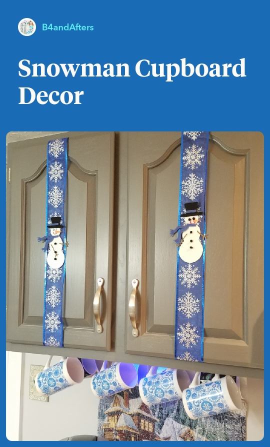 white snowmen on blue ribbon on gray cabinets