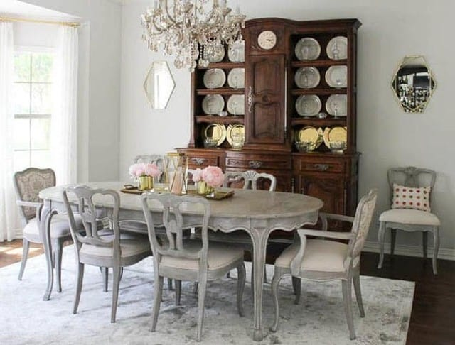 dining room with table, chairs, and hutch