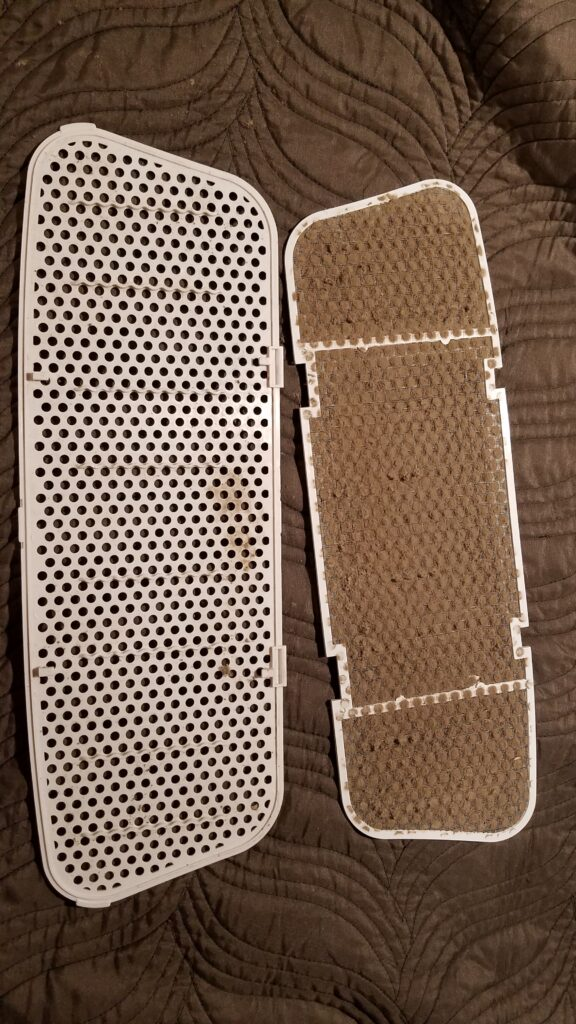 two dirty part of camper AC filter