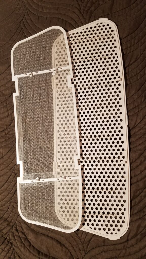 two pieces of clean AC ceiling filter