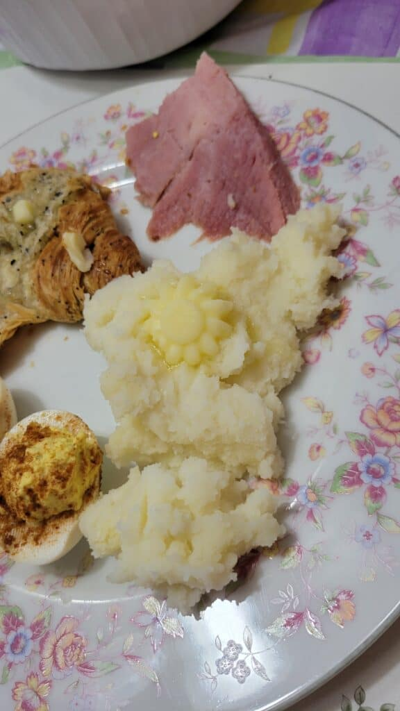flower butter pat on mashed potatoes