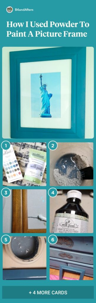 blue picture frame with Statue of Liberty