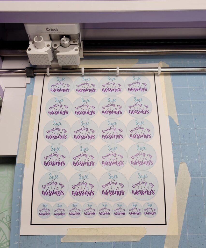sheet of stickers being cut on Cricut machine
