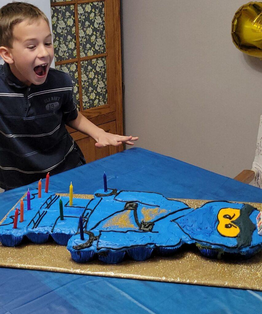 boy sees Lego Man Cake