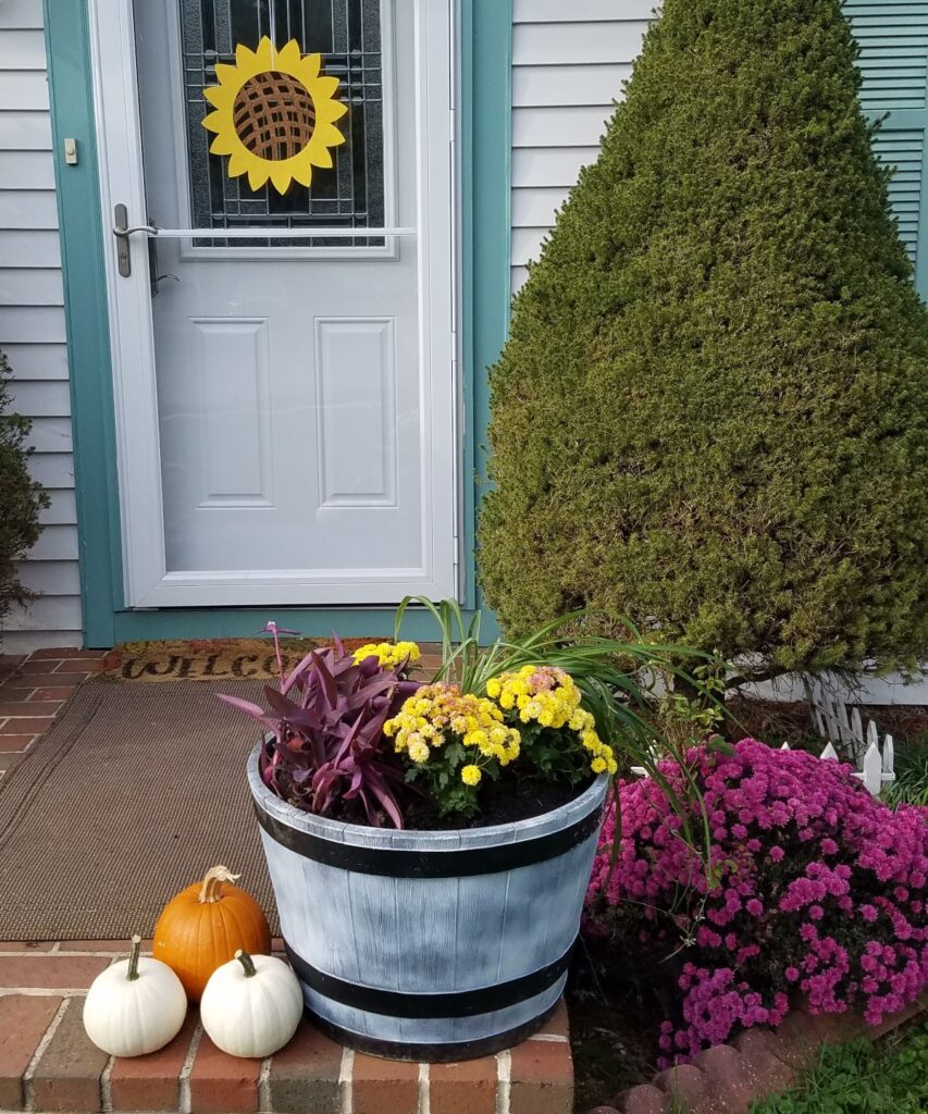 front step decorated for fall