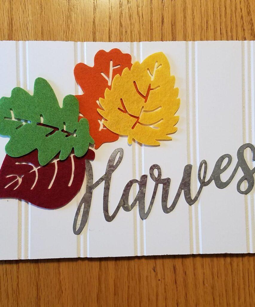 felt leaves and metal harvest word